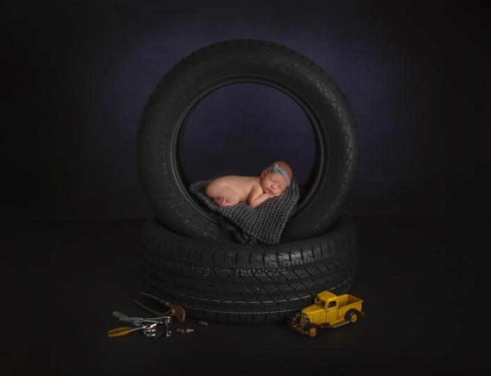 Newborn Photos baby sleeping in tires