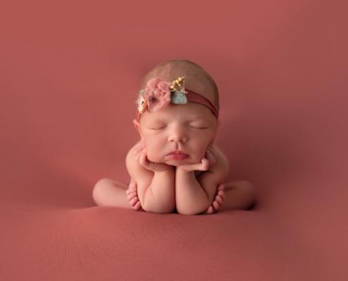 Newborn posing during newborn sessions