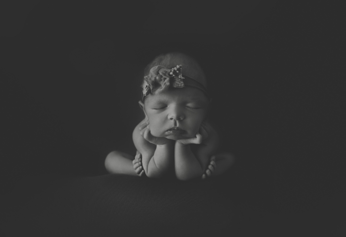 Baby posing in black and white