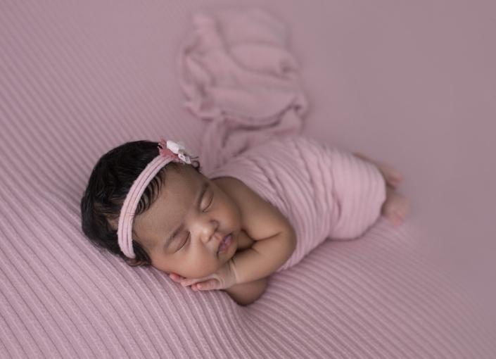 Newborn Photos baby with dark haur dressed in pink