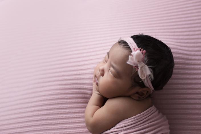 newborn with pink hair ribbon