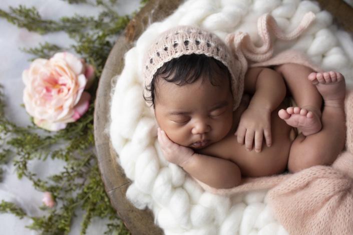 Newborn Photos baby with pink bonet