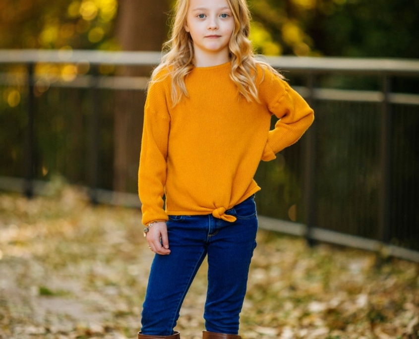 Girl wearing yellow sweater