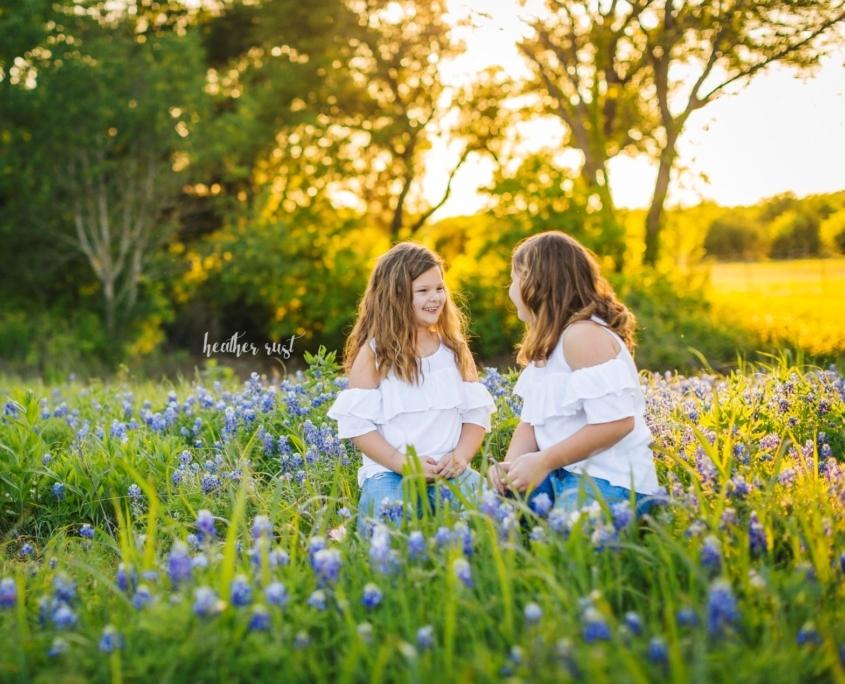 Girls in summer flower field