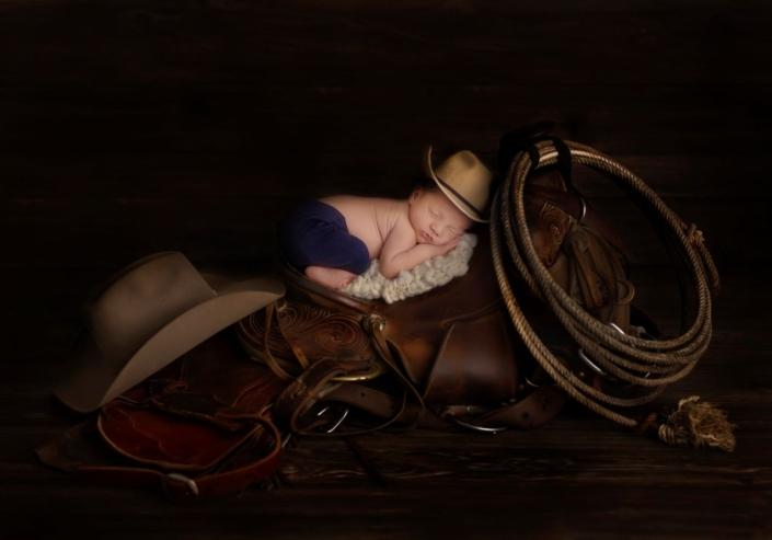 Newborn sleeping on saddle