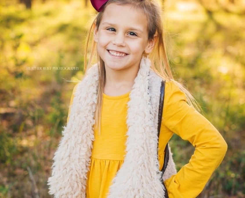 Portrait of girl in yellow dress