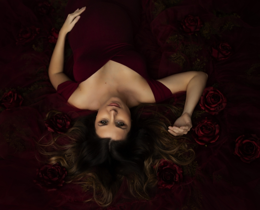 Waco Maternity Photographer session with red backdrop