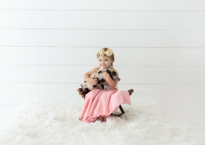 Girl with piglet
