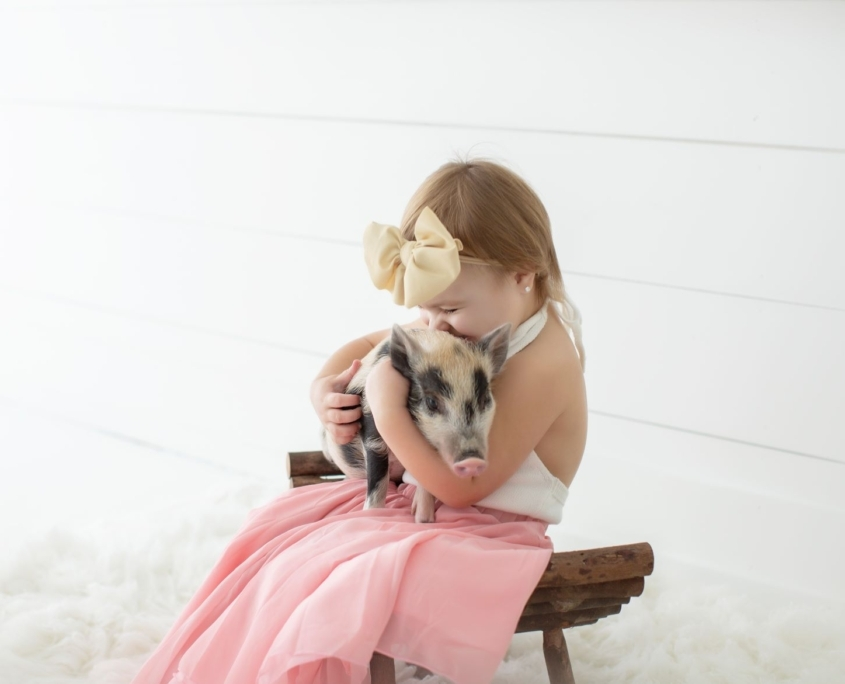 Little girl with piglet