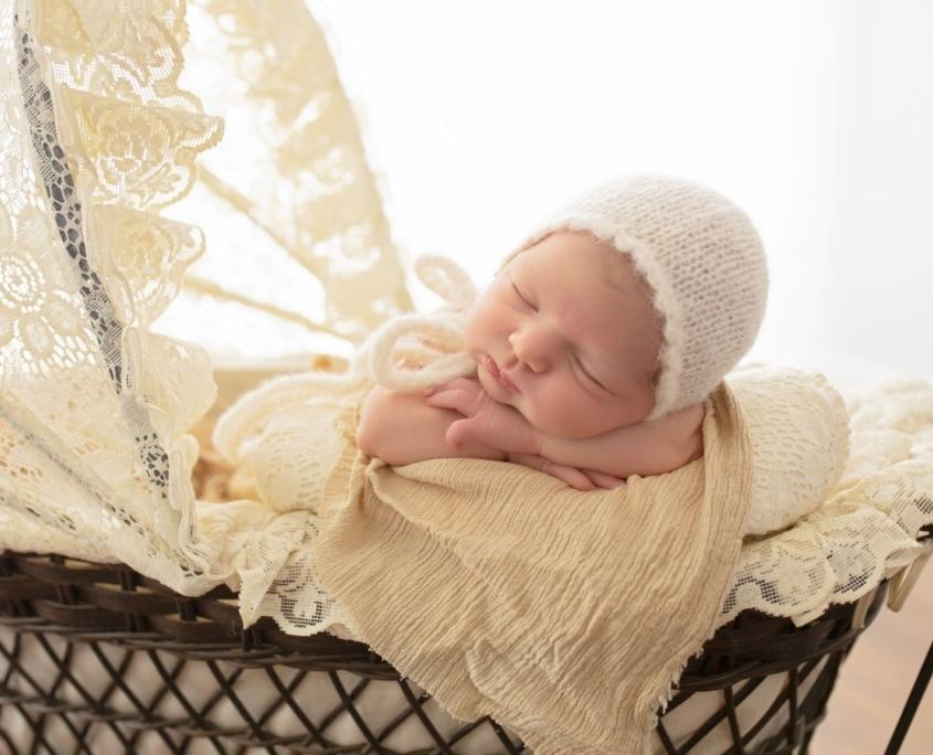 Baby sleeping in vintage stroller