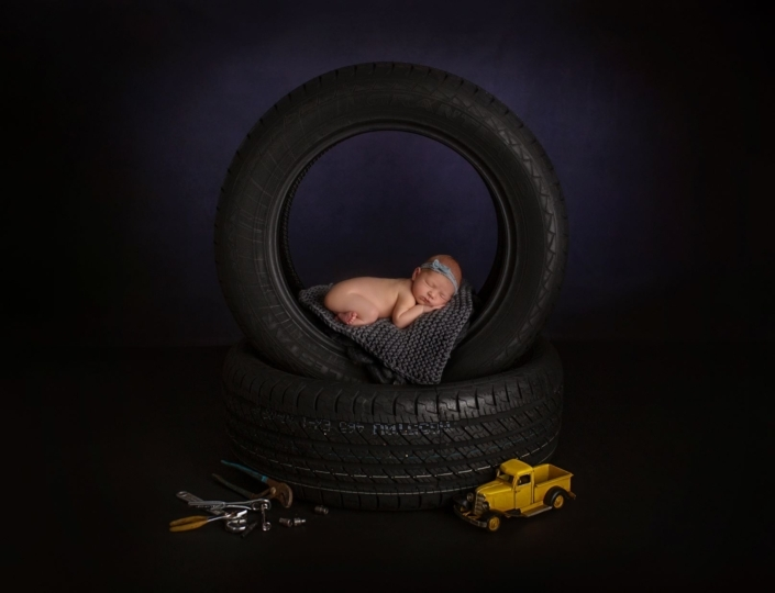 Newborn session with tires
