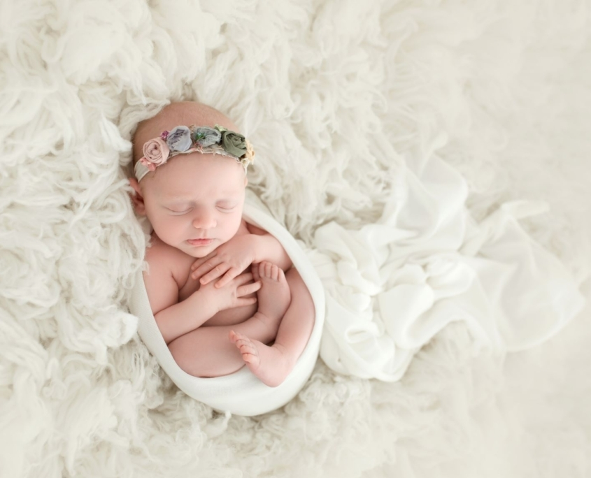 Portrait of newborn with white backdrop