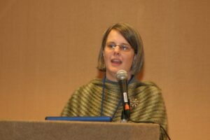 Image Shauna speaking at a national conference in Atlanta George on trauma education and self-care