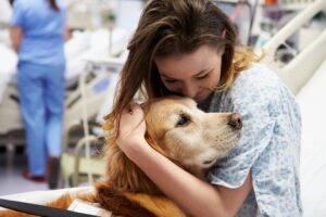 Female hugging dog