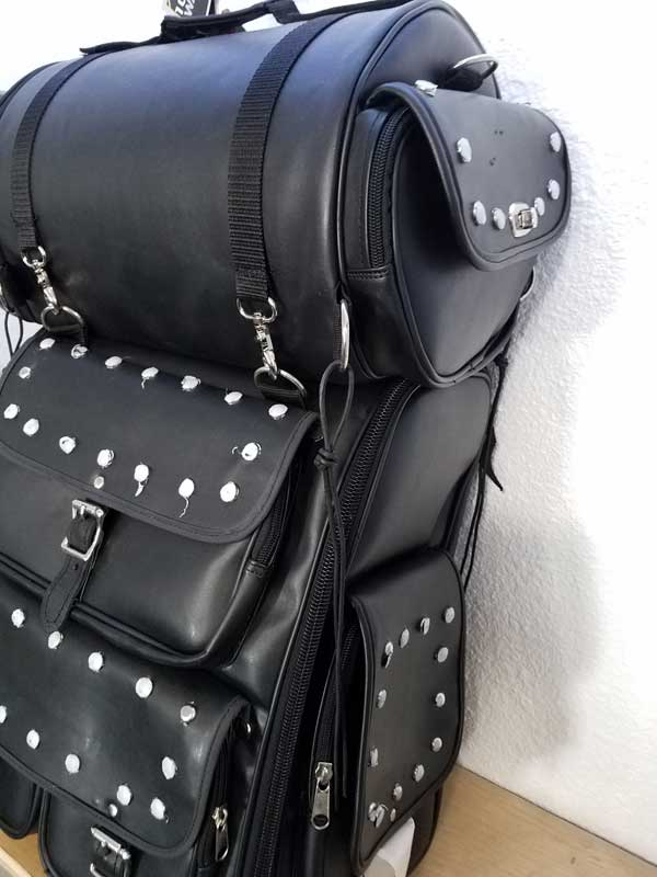 Leather travel pack with studs angled to the left