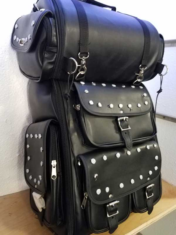 Leather Travel pack with studs angled to the right