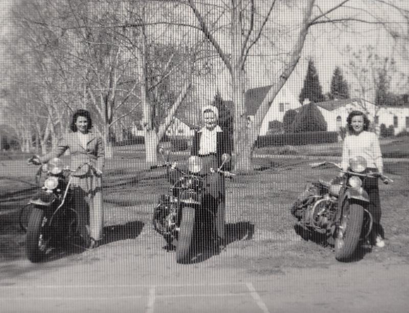 Three women riding motorcycles