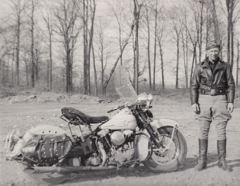 Person standing next to a motorcycle