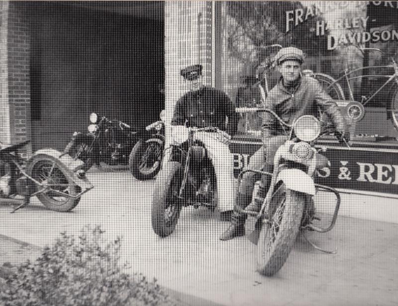 Two men riding motorcycles
