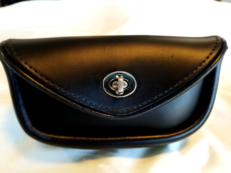 Handlebar bag with silver snap lock
