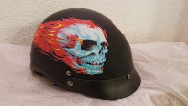 black helmet with skull and fire decal left angle