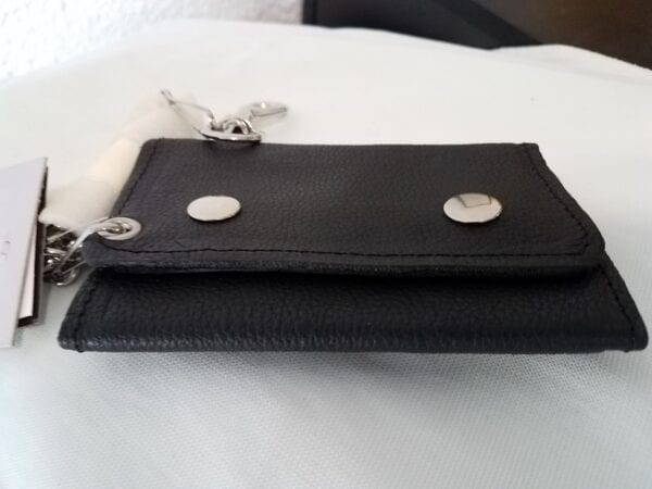 black leather wallet with silver buckles, flat