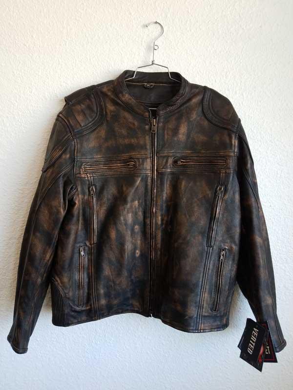 Brown faded biker jacket with gun