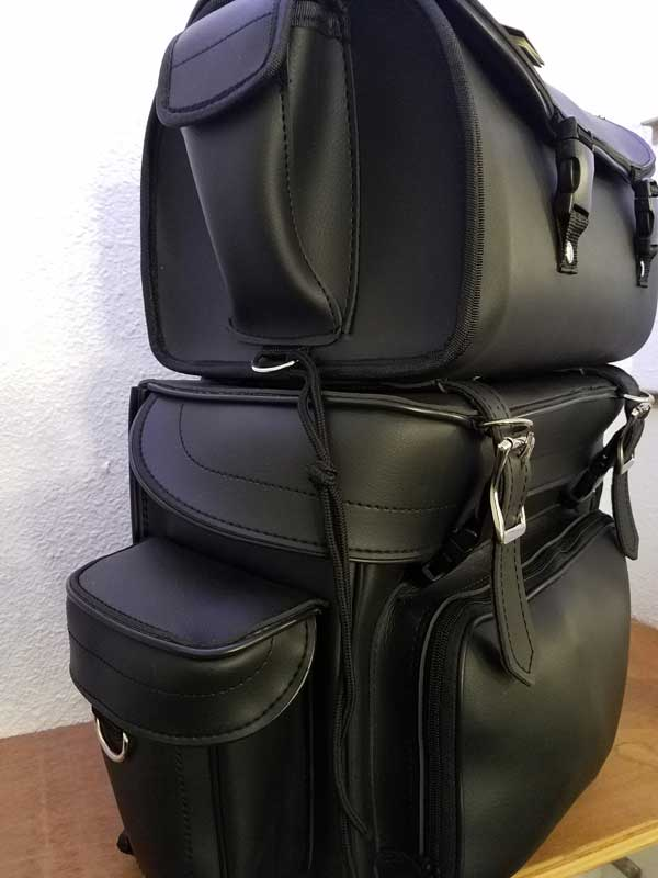 Three-Fourth view of black leather travel backpack