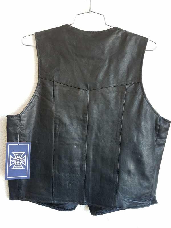 Rear plain black vest hanging on wall