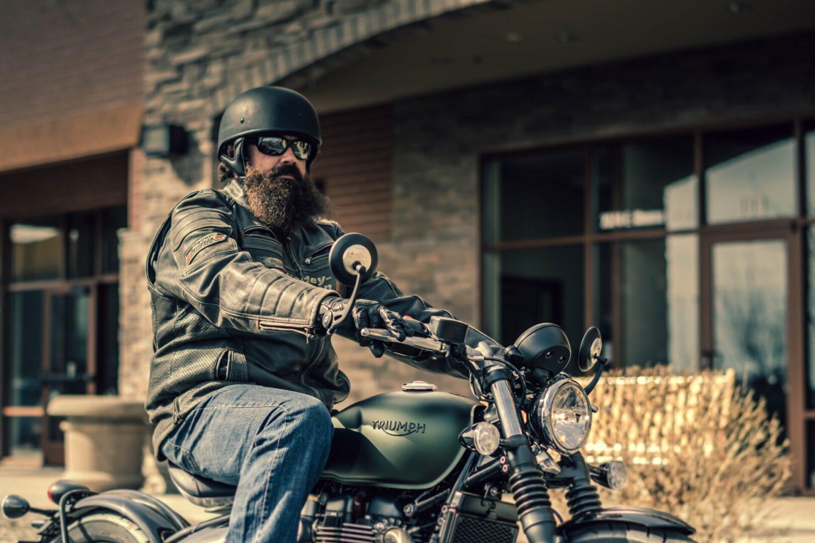selective-focus-photography-of-man-riding-cafe-racer-2036262