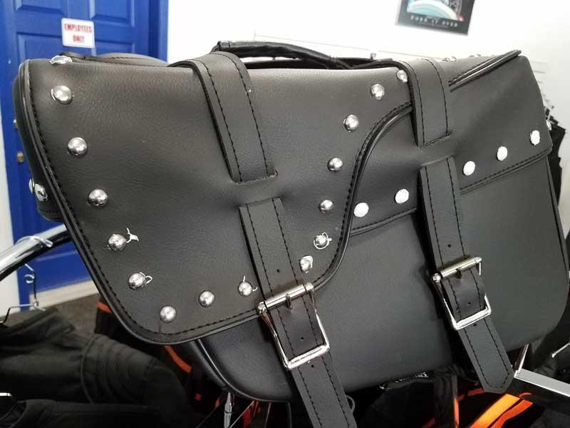 Studded black throw over saddlebags
