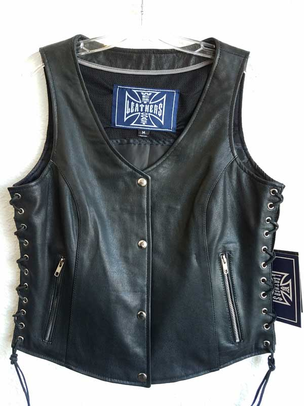 Women's black vest with silver holes and zip pockets