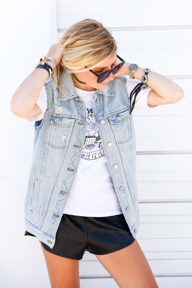denim vest and leather shorts