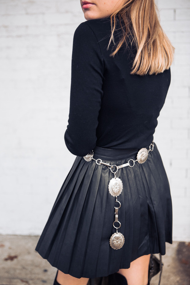 concho belt and pleated leather skirt