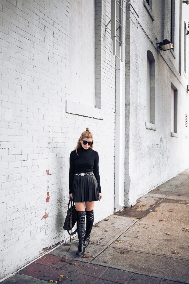 turtleneck and pleated leather skirt