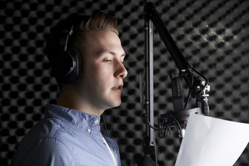 Man at microphone in a recording studio