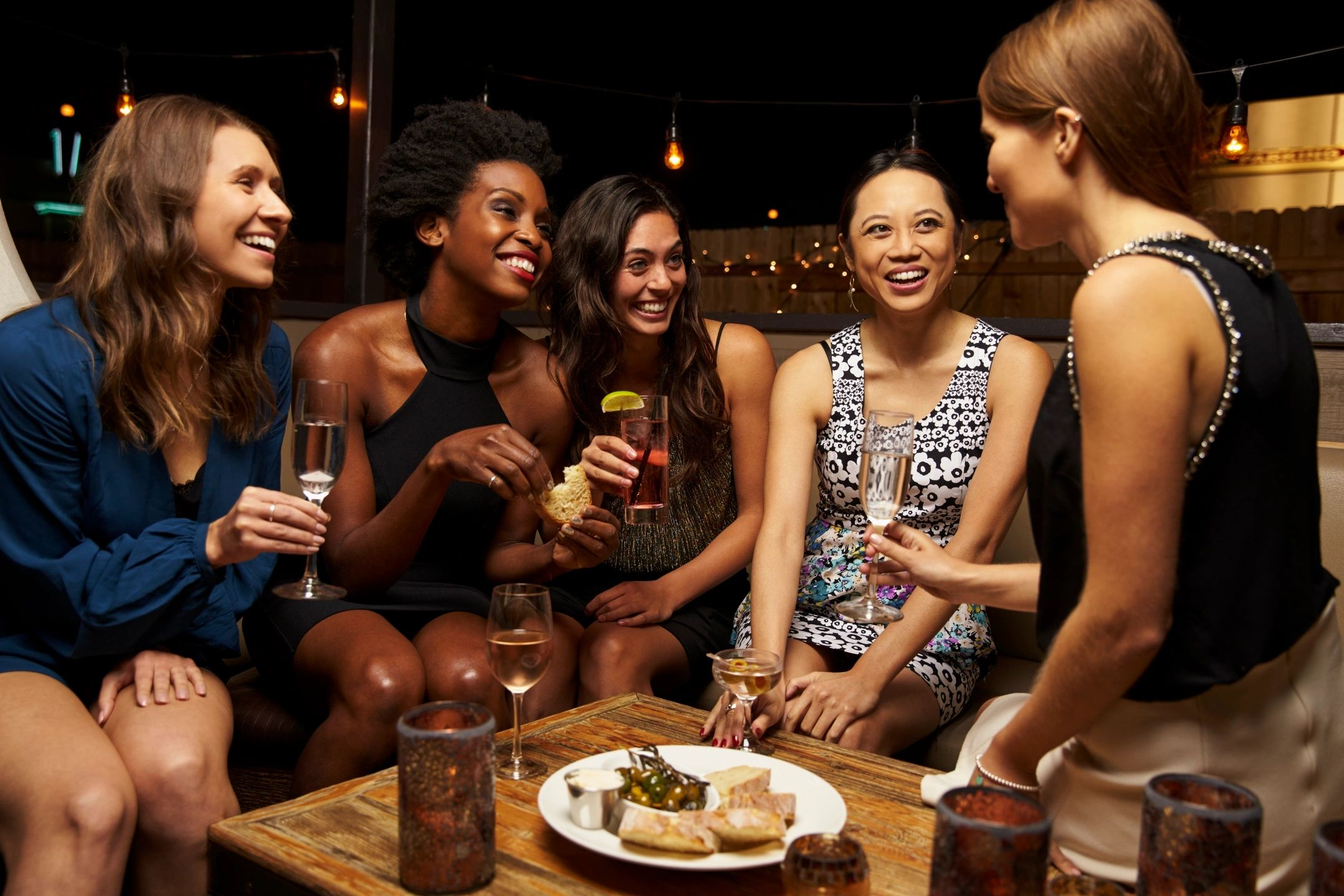 Ladies enjoying cocktails and appetizers