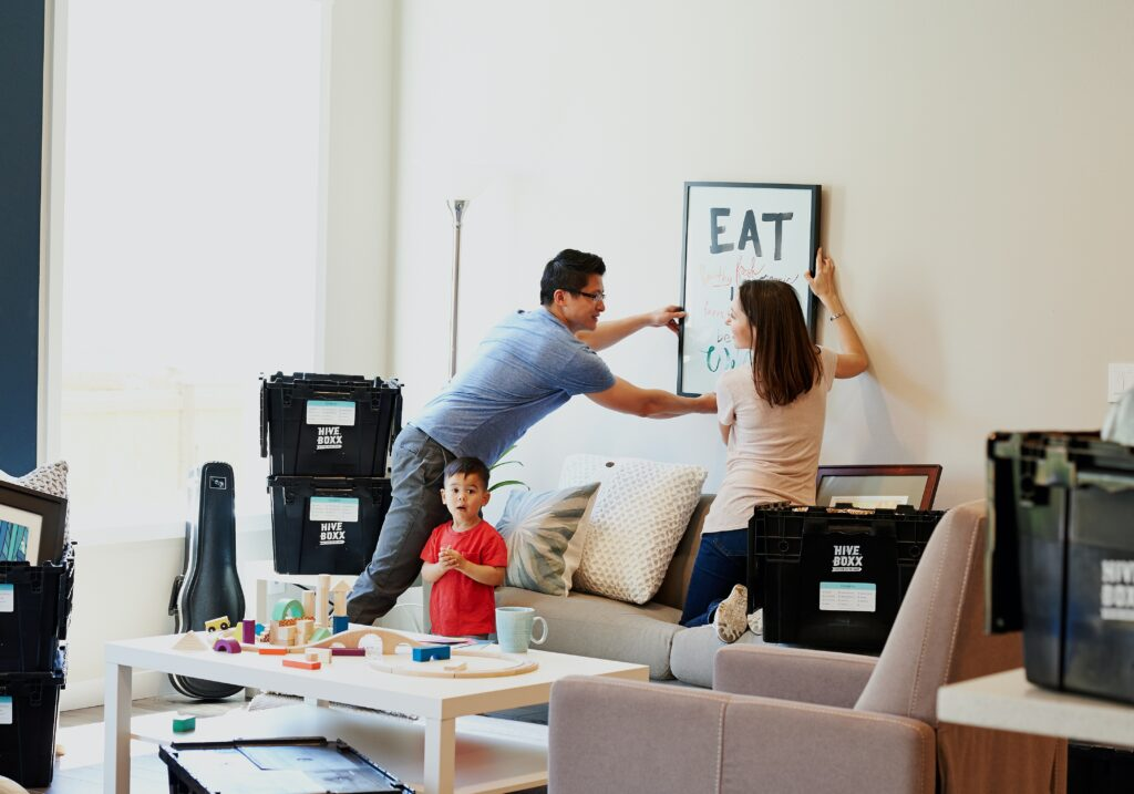 Couple Arranging New Home - Real Estate Agents