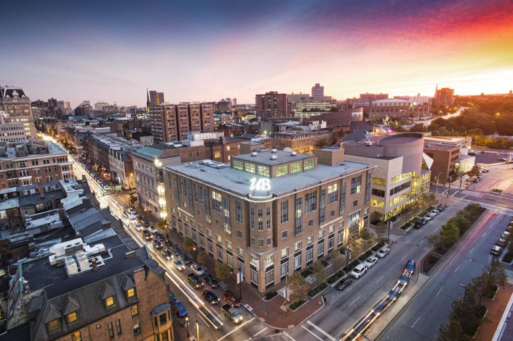 Skyline of Midtown Baltimore focused on University of Baltimore Thummel Business Center at dusk.