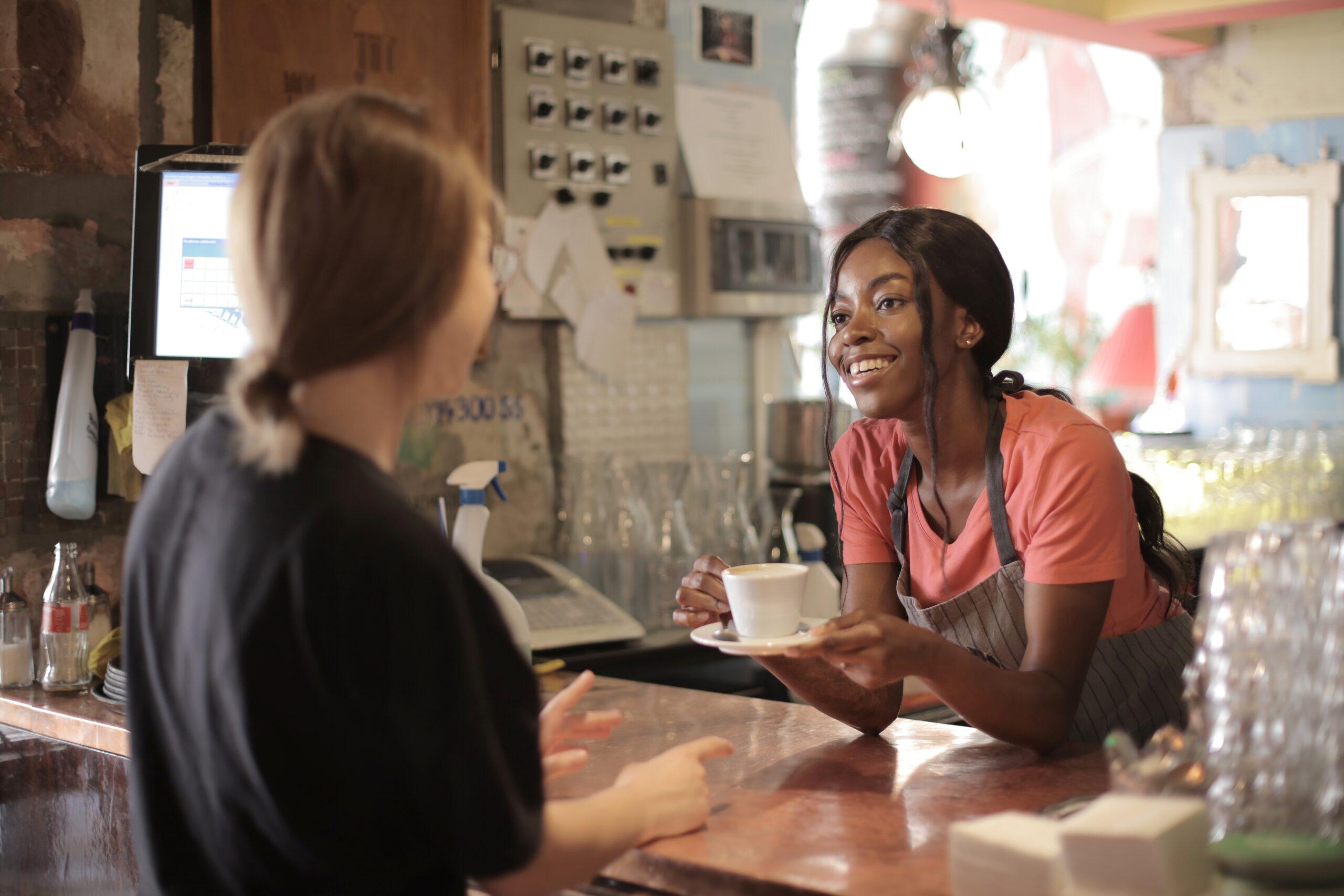 two women talking in a coffee shop