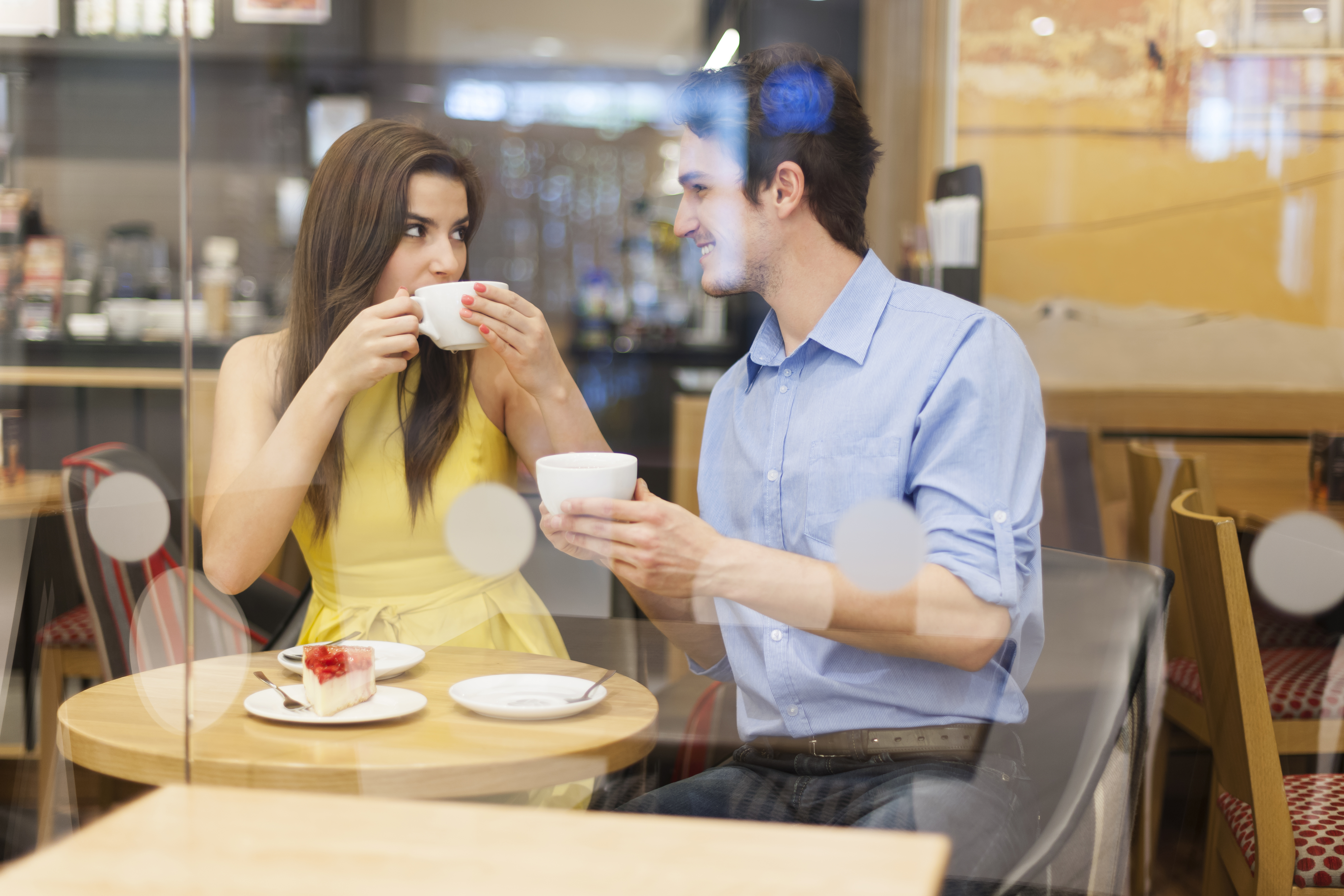 a-couple-on-a-coffee-date-at-a-small-coffee-shop