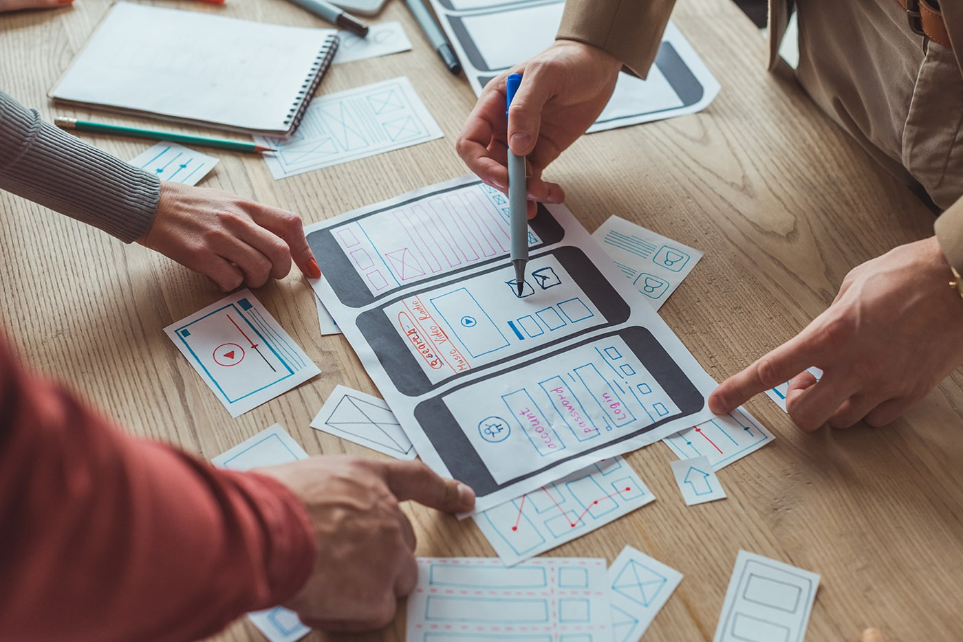 cropped-view-of-designers-working-with-app-sketch