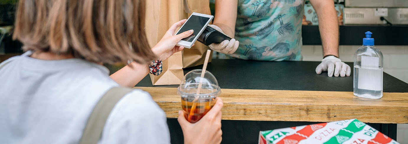 woman-paying-with-mobile-a-take-away-order-WFUCJRF-min