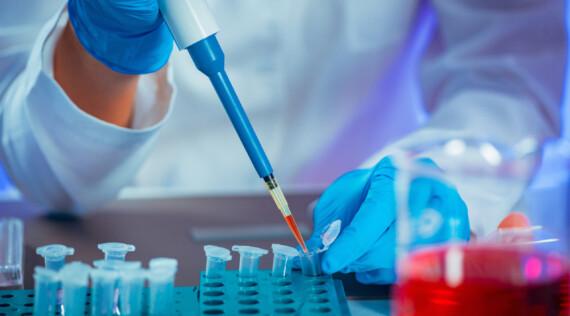 Female researcher using micro pipette