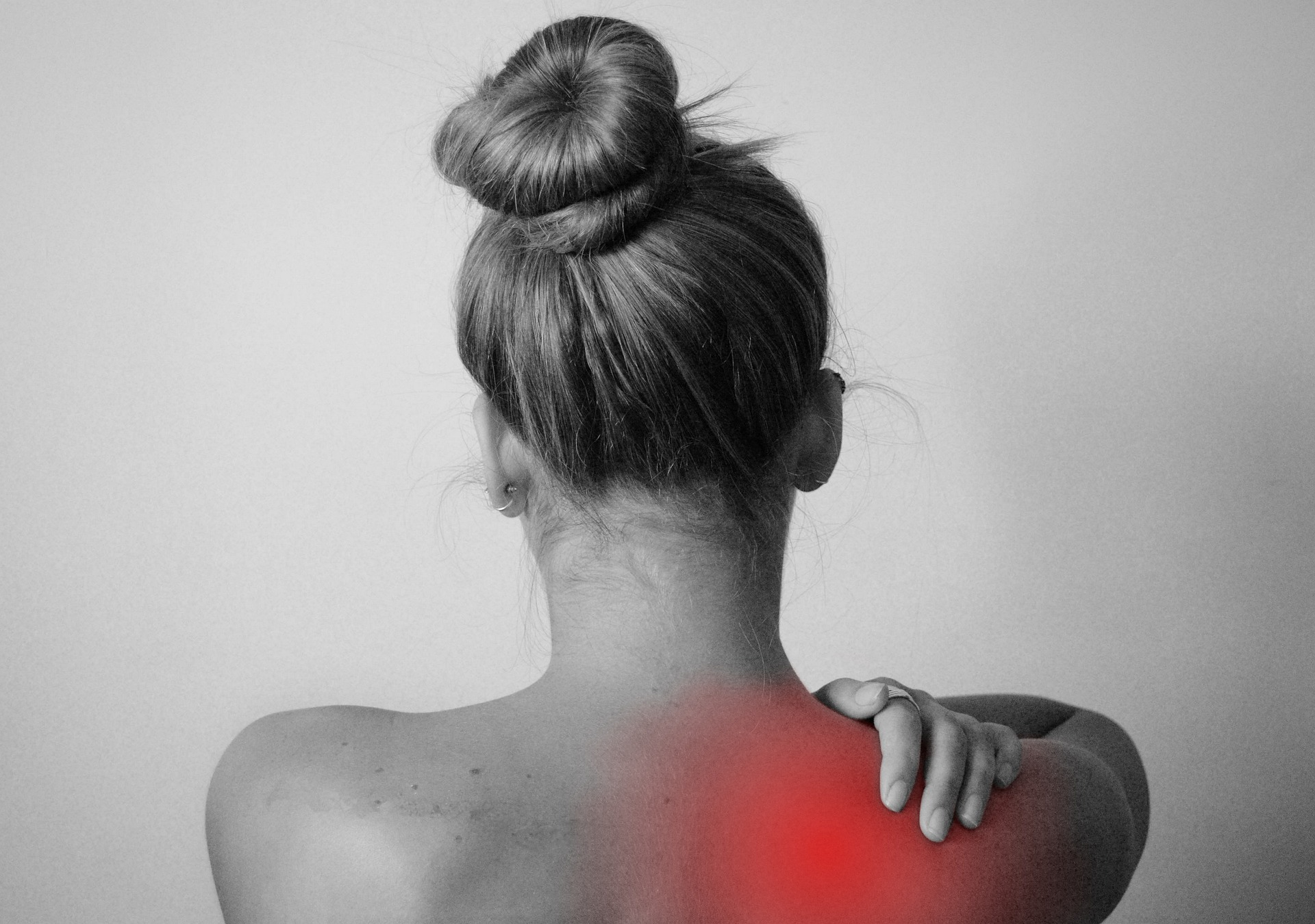 woman showing back pain - inflammation