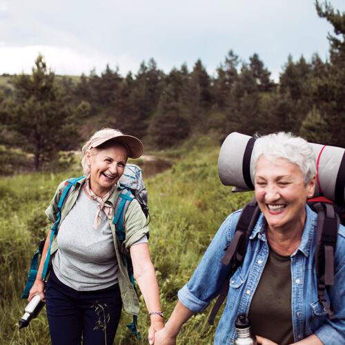Empower yourself through Naturopathic Oncology from Aspen Integrative Medical Center in Flagstaff, Arizona. Friends hiking and celebrating the use of naturopathic care as part of her cancer treatments.