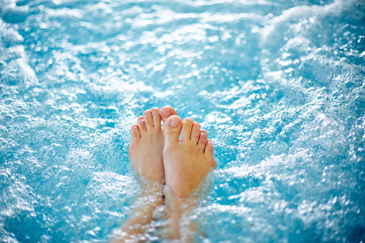 bare feet in hydrotherapy bath