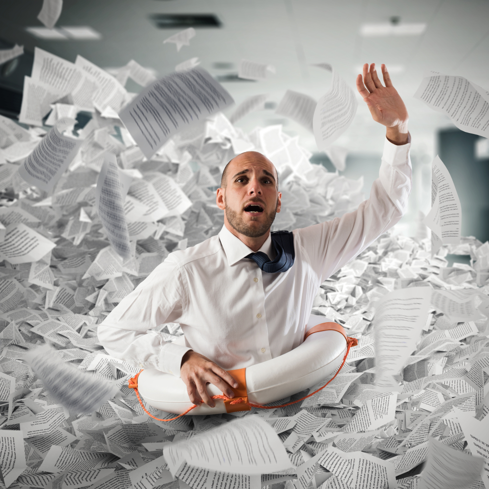 InspiredGrowthPortal business man with life buoy drowing in paperwork shutterstock