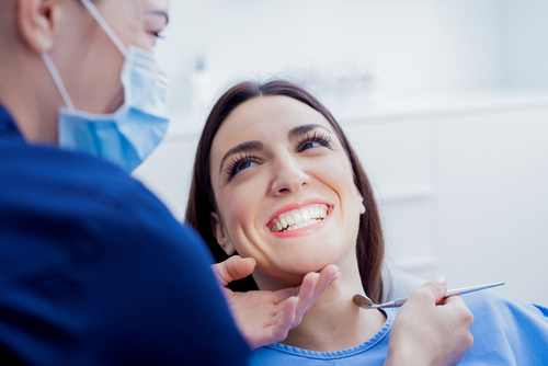 A woman showcasing some of our cosmetic dentistry services in Media, PA
