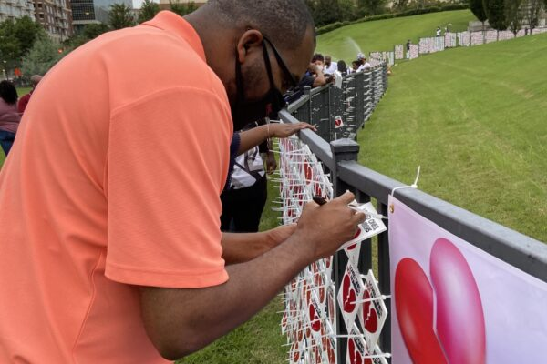 Ken Edwards signs heart for mother